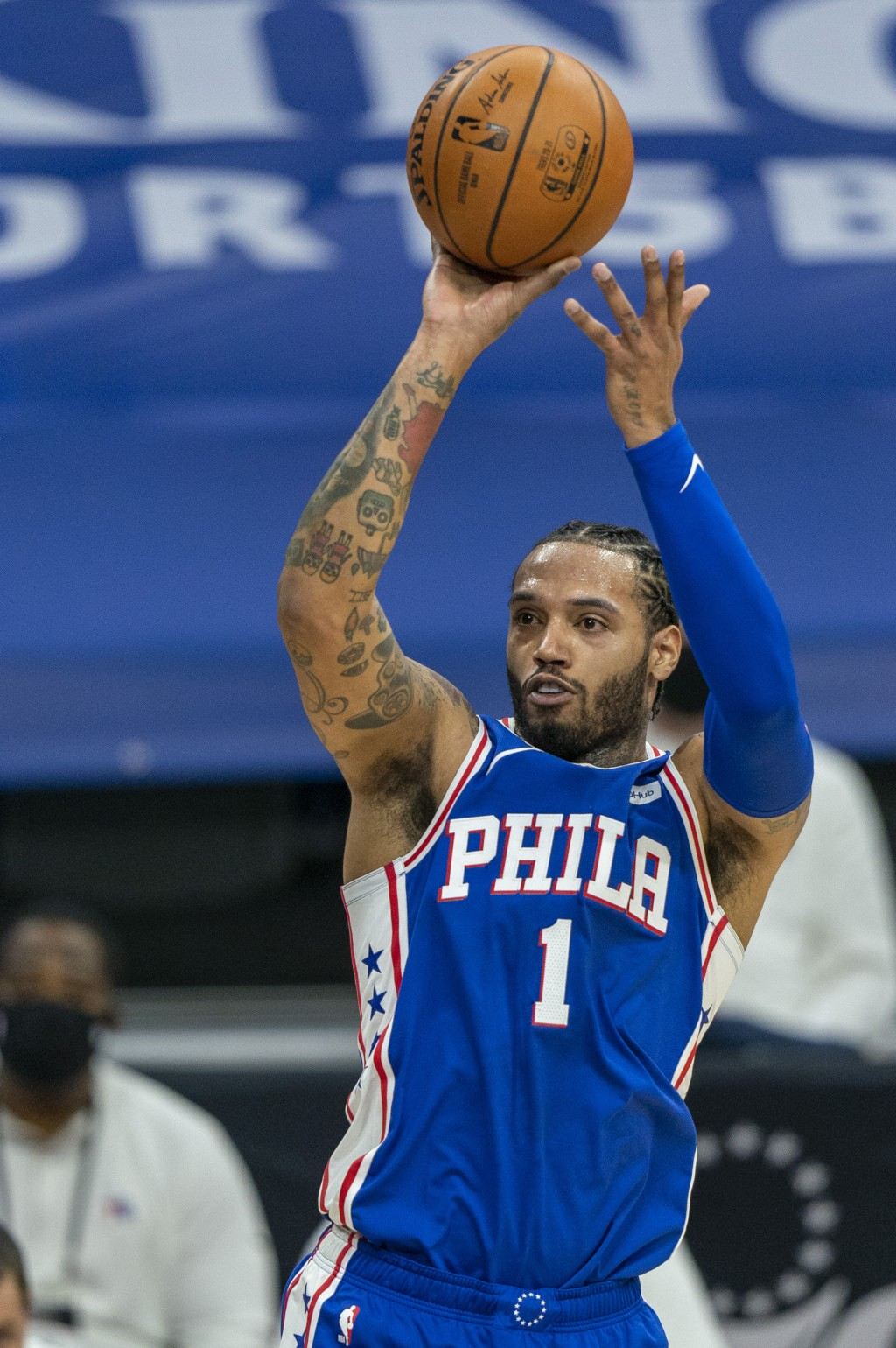 Philadelphia 76ers' Mike Scott shoots a 3-pointer during the first half of the team's NBA basketball game against the Miami Heat, Tuesday, Jan. 12, 20...