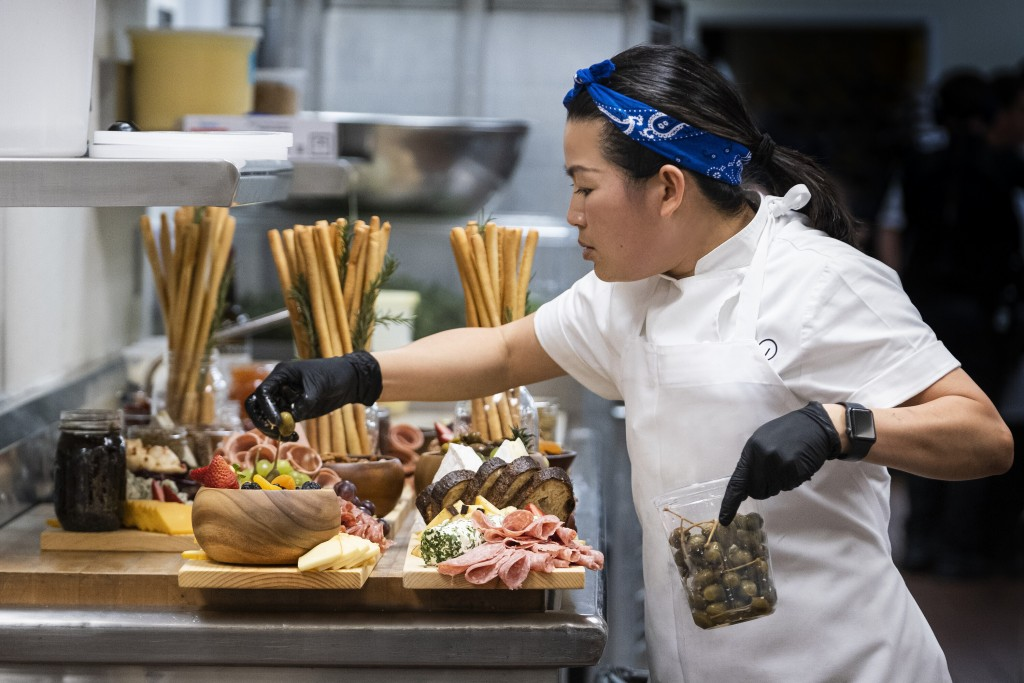 """This image released by HBO Max shows Chef Pauline in a scene from the four-part documentary series, """"The Event,"""" which shows the intense planning and ..."""