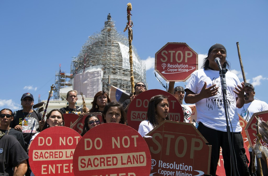 FILE - In this July 22, 2015, file photo, Tribal councilman Wendsler Nosie, Sr. speaks with Apache activists in a rally to save Oak Flat, land near Su...