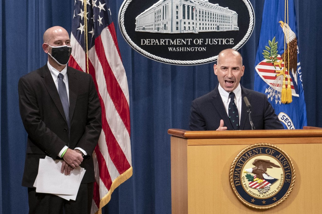 Steven D'Antuono, head of the Federal Bureau of Investigation (FBI) Washington field office, left, listens as acting U.S. Attorney Michael Sherwin, sp...