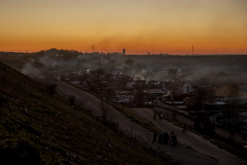 A general view during the sunset at the Canada Real shanty town, outside Madrid, Spain, Tuesday, Jan. 5, 2021. An illegal informal settlement that has...