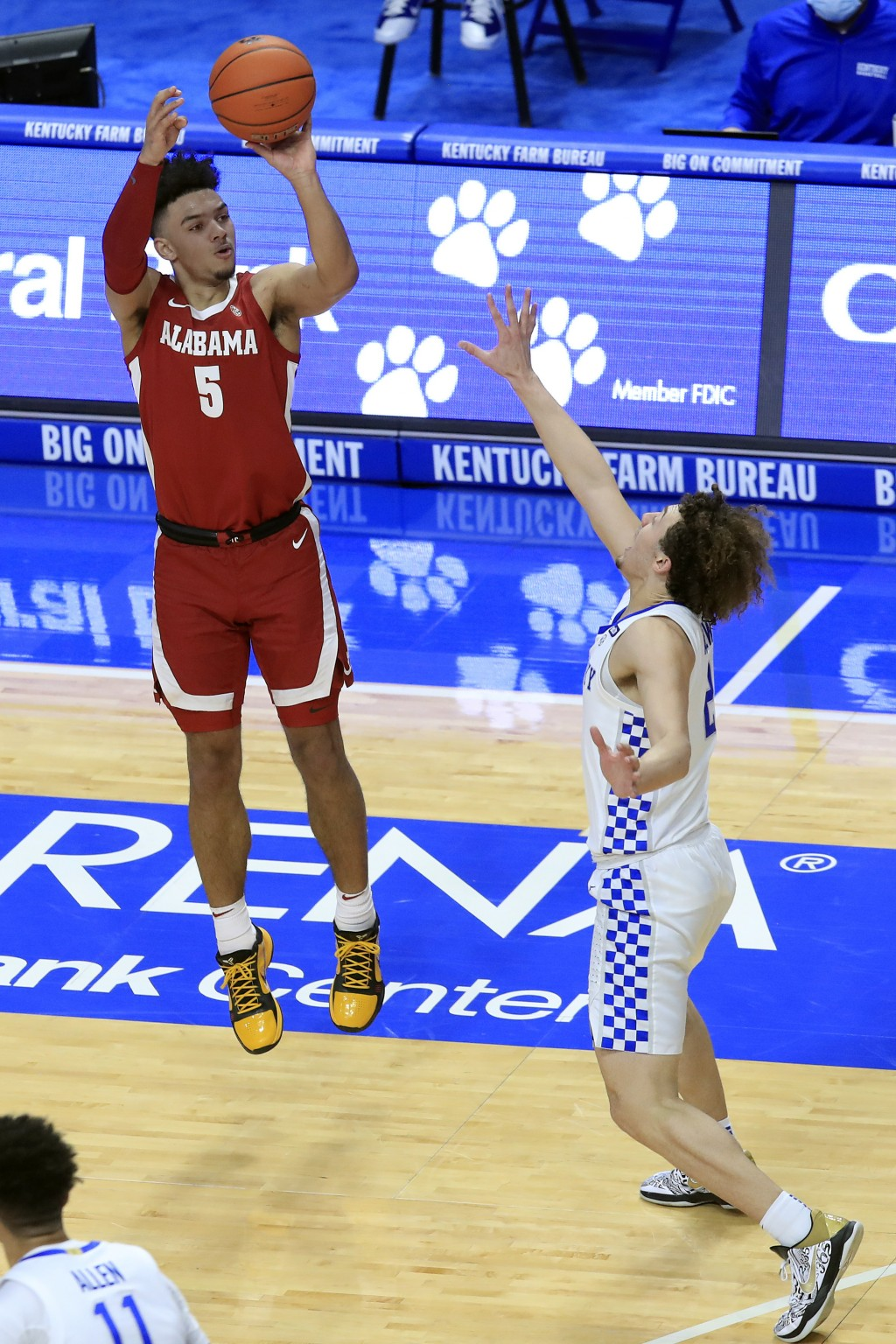 Alabama's Jaden Shackelford (5) shoots a 3-pointer over Kentucky's Devin Askew during the first half of an NCAA college basketball game in Lexington, ...