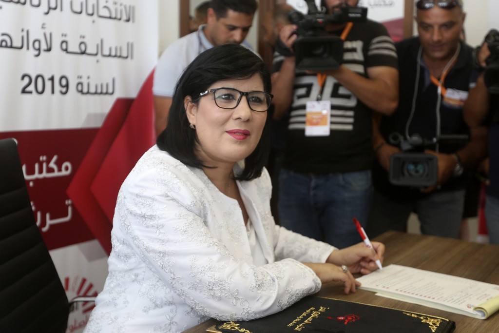 FILE - In this Aug. 2, 2019 file photo, President of the Free Destourian Party (PDL) Abir Moussi submits her candidacy for the upcoming presidential e...