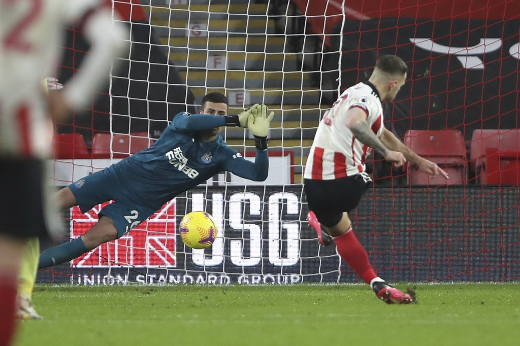Sheffield United's Billy Sharp scores his side's first goal from the penalty spot during the English Premier League soccer match between Sheffield Uni...