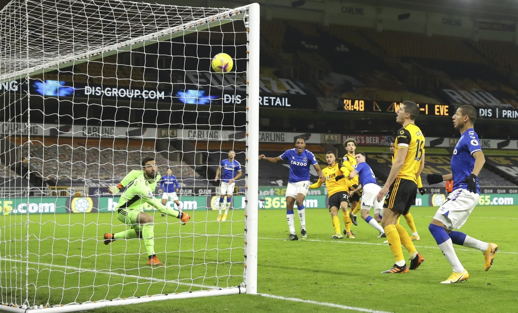 Wolverhampton Wanderers' goalkeeper Rui Patricio fails to save the goal from Everton's Michael Keane during the English Premier League soccer match be...