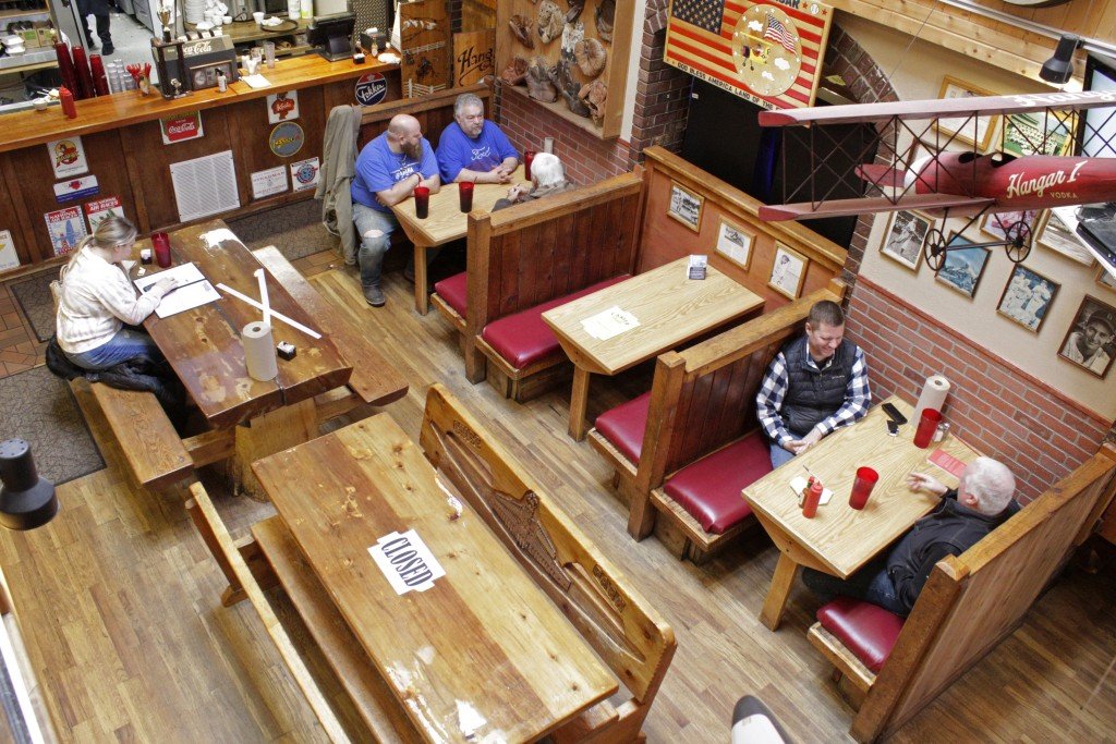 Diners sit at the Carver Hangar, a restaurant in Boring, Ore., on Jan. 6, 2021. As coronavirus deaths soar, a growing number of restaurants like Carve...