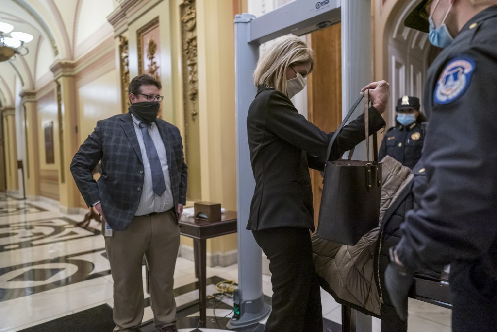 Metal detectors are set up for lawmakers and staff before entering the House chamber, a new security measure put into place after a mob loyal to Presi...
