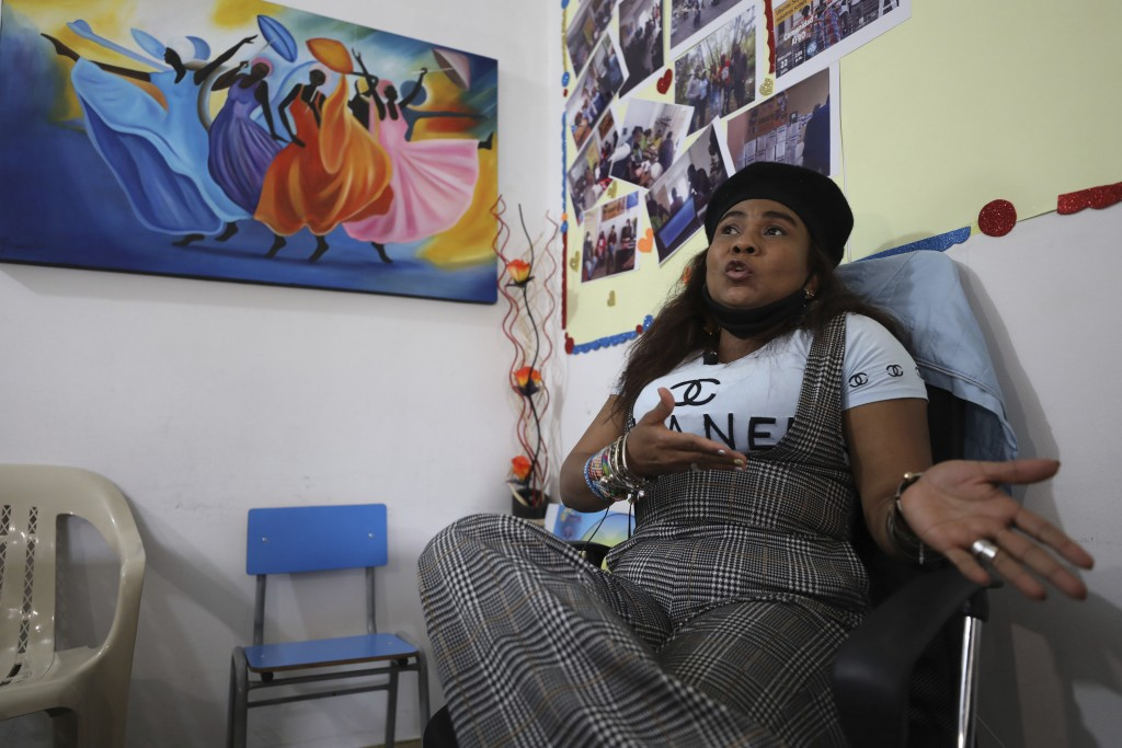 Community leader Luz Nelly Santana, whose life has been threatened by illegal armed groups, talks during an interview in Bogota, Colombia, Thursday, D...