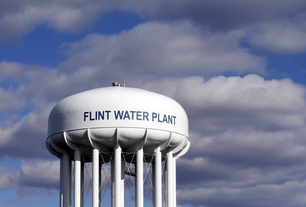 FILE - In this March 21, 2016, file photo, the Flint Water Plant water tower is seen in Flint, Mich. Former Michigan Gov. Rick Snyder, Nick Lyon, form...