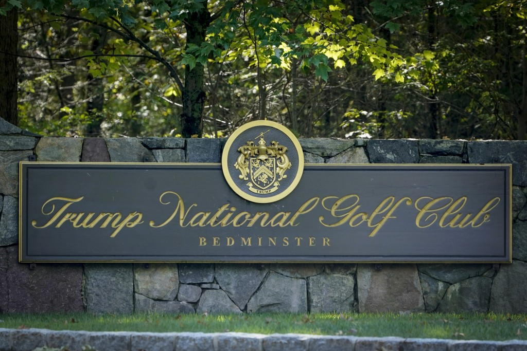 FILE - This photo from Friday Oct. 2, 2020, shows a sign at the entrance to Trump National Golf Club in Bedminster, N.J. The PGA canceled its tourname...