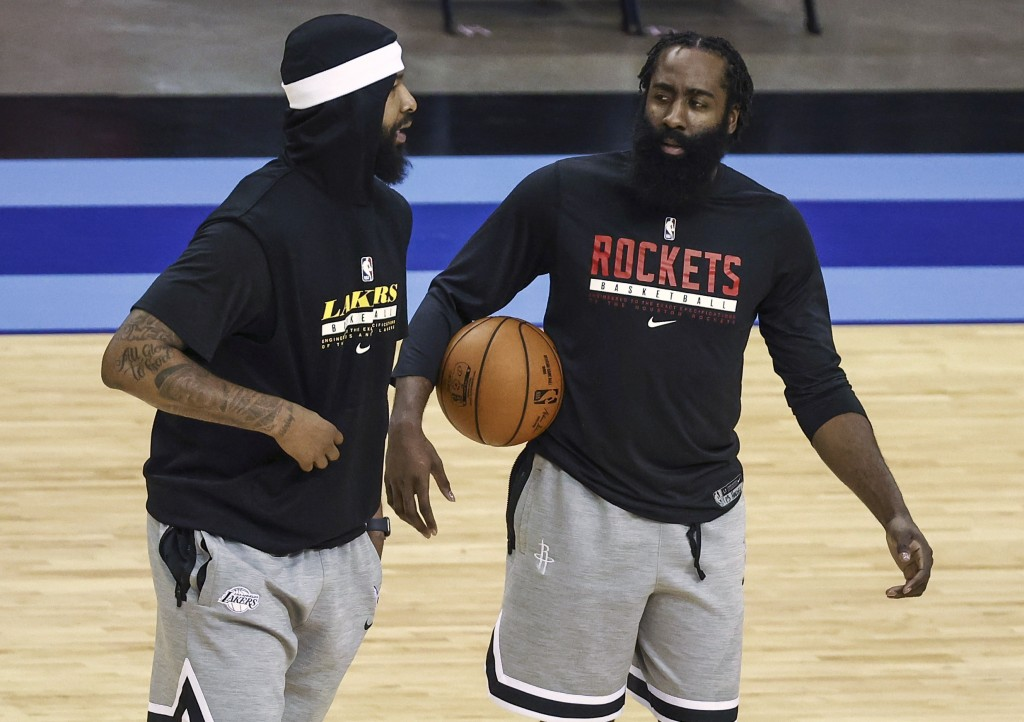 Houston Rockets guard James Harden, right, talks with Los Angeles Lakers forward Markieff Morris before an NBA basketball game Tuesday, Jan. 21, 2021,...