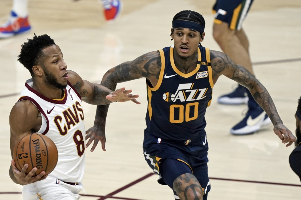 Cleveland Cavaliers' Lamar Stevens (8) drives to the basket against Utah Jazz's Jordan Clarkson (00) in the second half of an NBA basketball game, Tue...