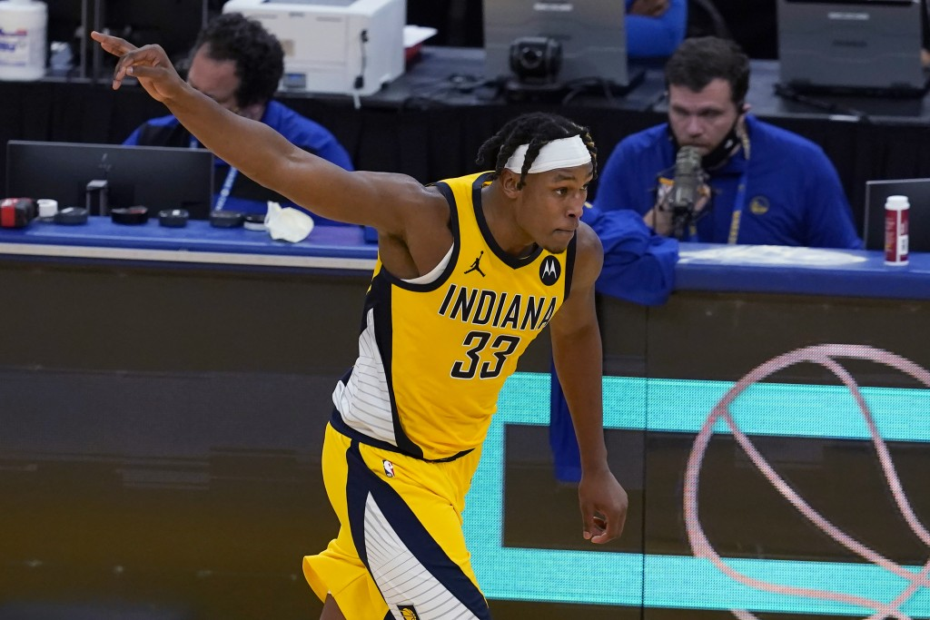 Indiana Pacers center Myles Turner celebrates after shooting a 3-point basket against the Golden State Warriors during the second half of an NBA baske...