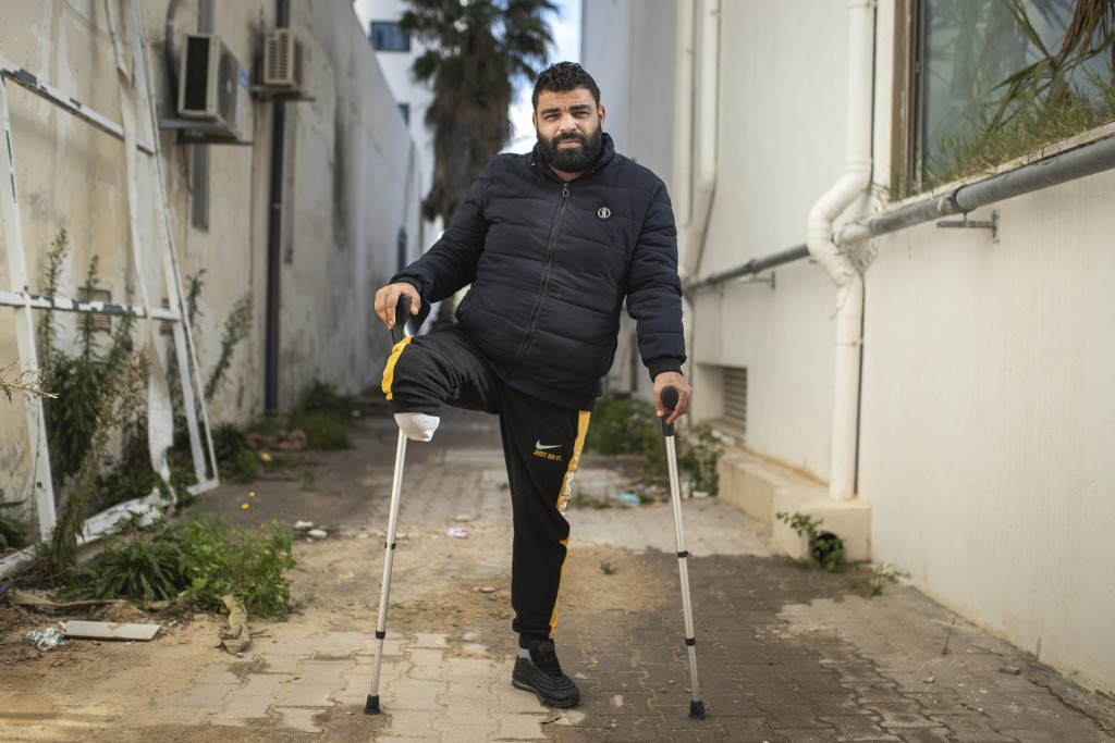 Muslim Gasdallah, 31, a protester who lost a leg after getting shot during Tunisia's democratic uprising 10 years ago poses for a portrait in Tunis, T...