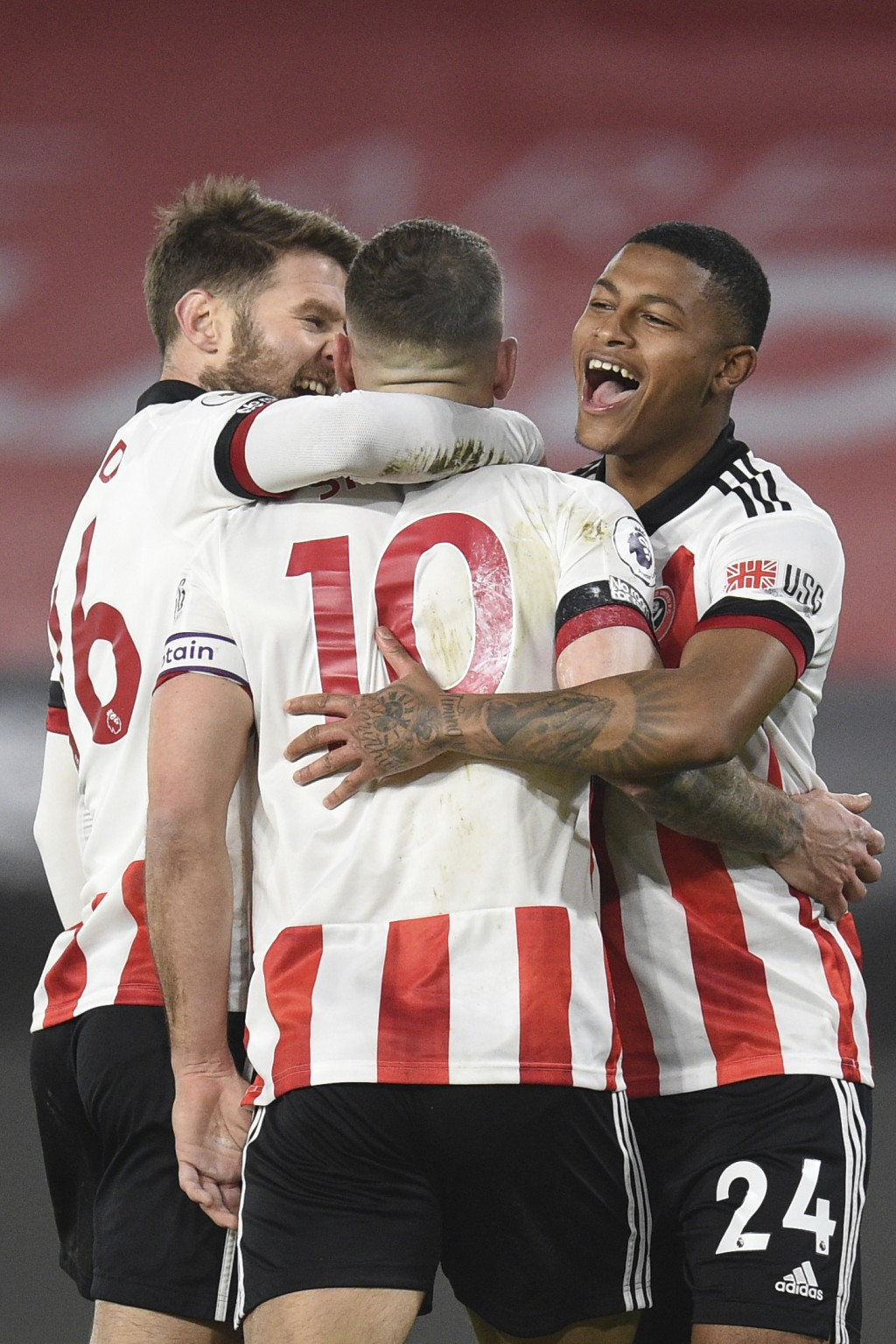 Sheffield United's Billy Sharp, center, celebrates after scoring his side's first goal during the English Premier League soccer match between Sheffiel...