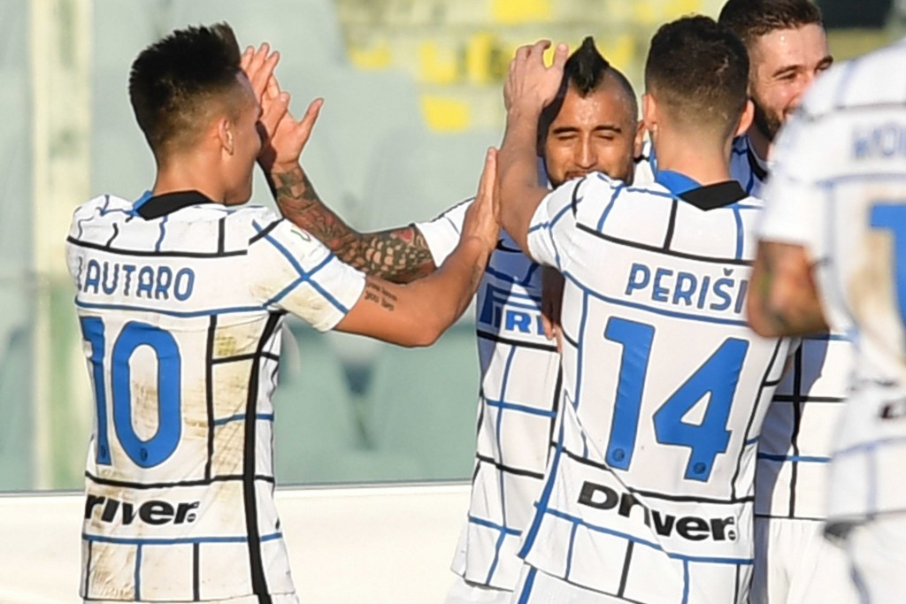 Inter's Vidal, center, celebrates with teammates after scoring his side's first goal on a penalty kick during the Italian Cup round of 16 soccer match...