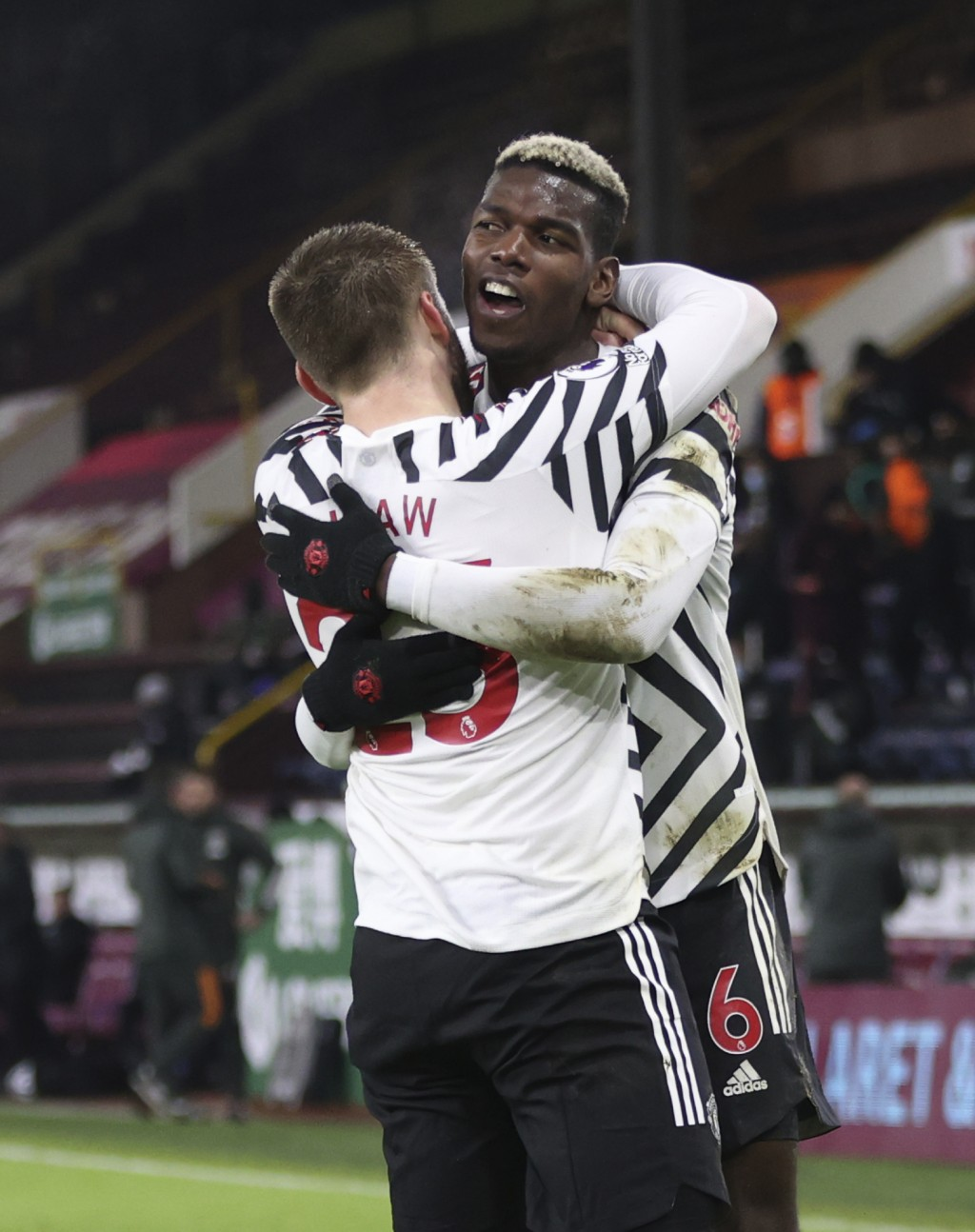Manchester United's Paul Pogba celebrates after scoring during the English Premier League soccer match between Burnley and Manchester United in Burnle...
