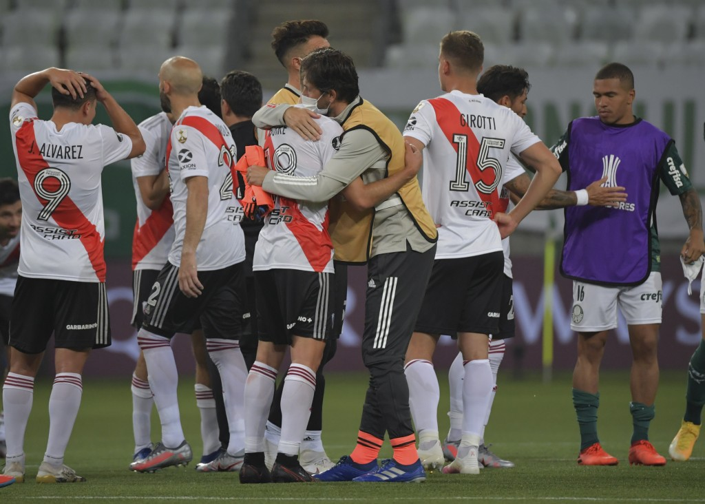 Players of Argentina's River Plate stand on the field at the end of a Copa Libertadores semifinal second leg soccer match against Brazil's Palmeiras a...