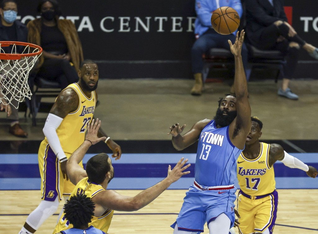 Houston Rockets guard James Harden (13) passes the ball against the Los Angeles Lakers during the third quarter of an NBA basketball game Tuesday, Jan...