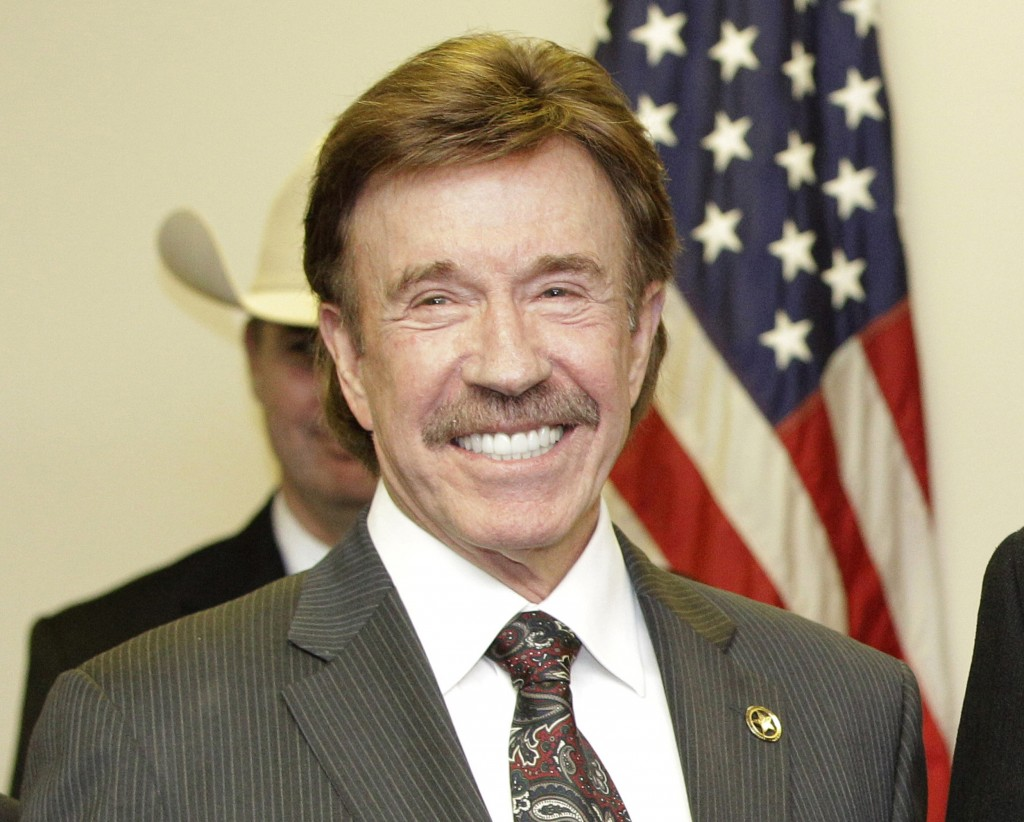 """FILE - In this Dec. 2, 2010, file photo, actor Chuck Norris stands following a ceremony in Garland, Texas. Norris' manager says the """"Walker, Texas Ran..."""