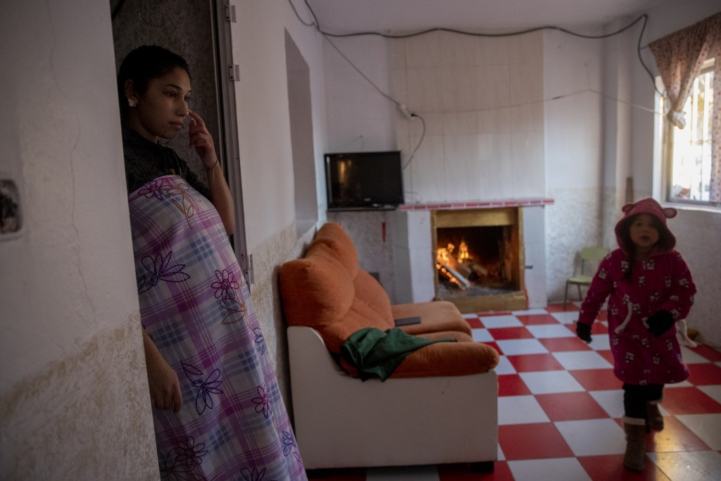 Eight months pregnant Silvia Fernandez, 16, stands in her home at the Canada Real shanty town, outside Madrid, Spain, Tuesday, Jan. 12, 2021. As a rec...