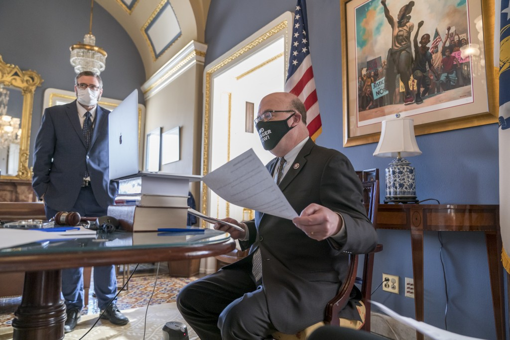House Rules Committee Chairman Jim McGovern, D-Mass., right, leads a partially-virtual hearing to consider a resolution calling on Vice President Mike...