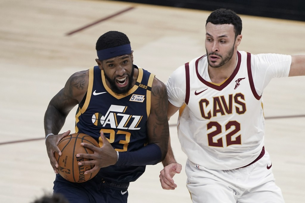 Utah Jazz's Royce O'Neale (23) drives against Cleveland Cavaliers' Larry Nance Jr. (22) during the first half of an NBA basketball game Tuesday, Jan. ...