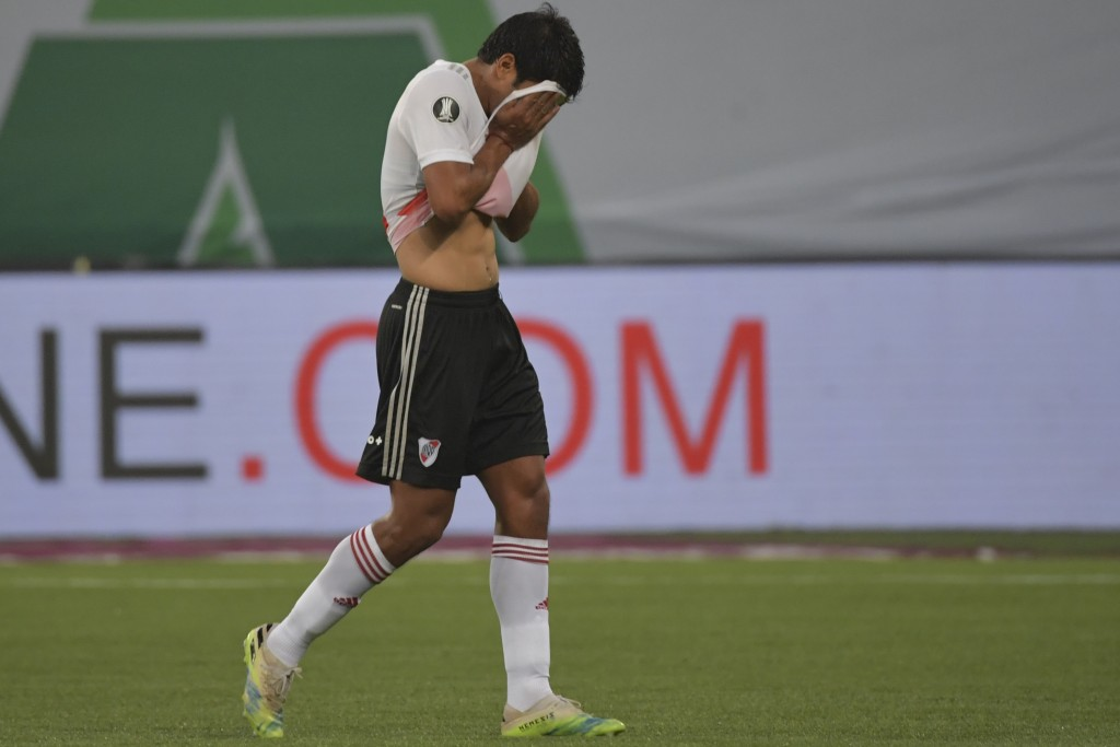 Robert Rojas of Argentina's River Plate leaves the field after receiving a red card during a Copa Libertadores semifinal second leg soccer match again...