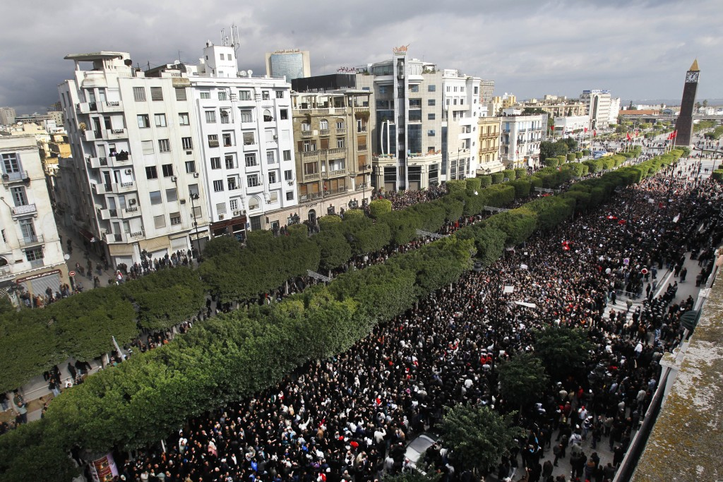 FILE - In this Friday, Jan. 14, 2011 file photo, protesters chant slogans against President Zine El Abidine Ben Ali during a demonstration in Tunis. S...