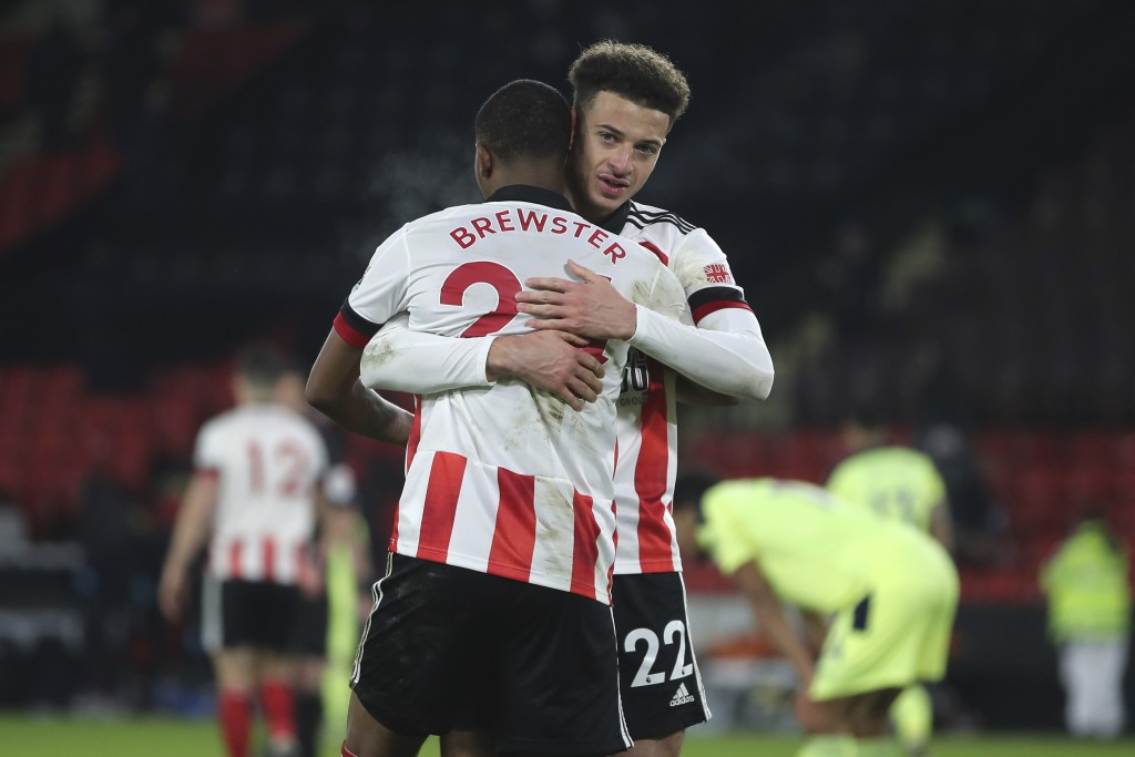 Sheffield United's players celebrate after the English Premier League soccer match between Sheffield United and Newcastle United at the Bramall Lane s...