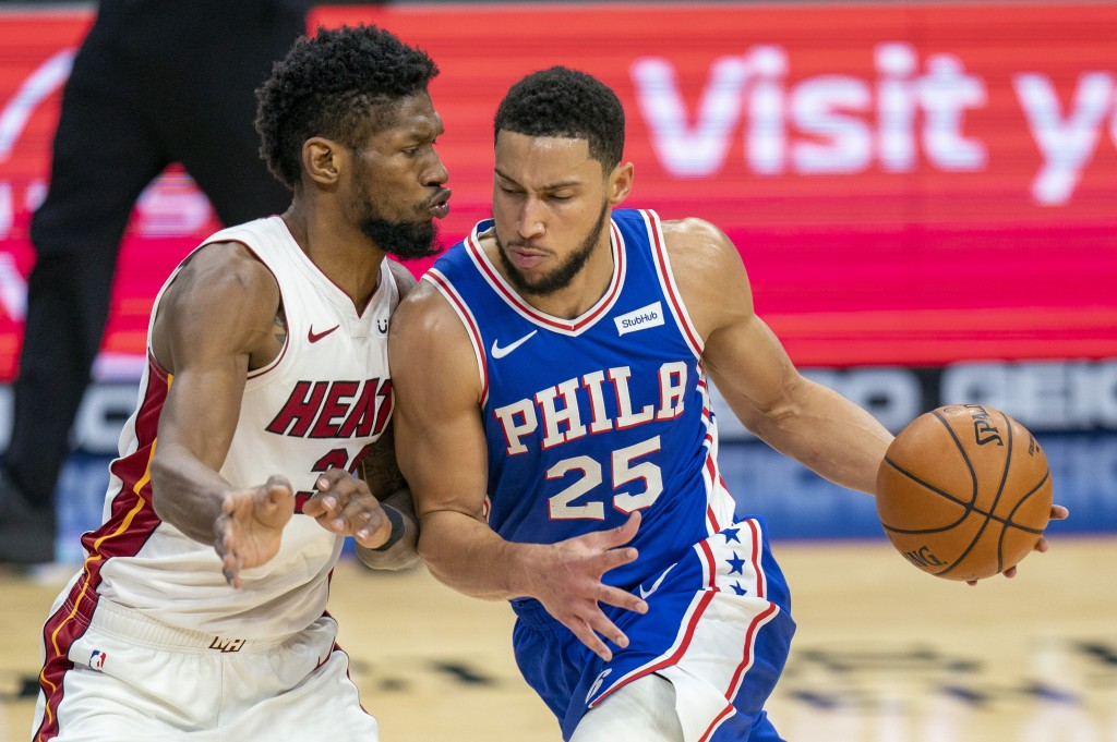 Philadelphia 76ers' Ben Simmons, right, drives against Miami Heat's Chris Silva, left, during the first half of an NBA basketball game Tuesday, Jan. 1...