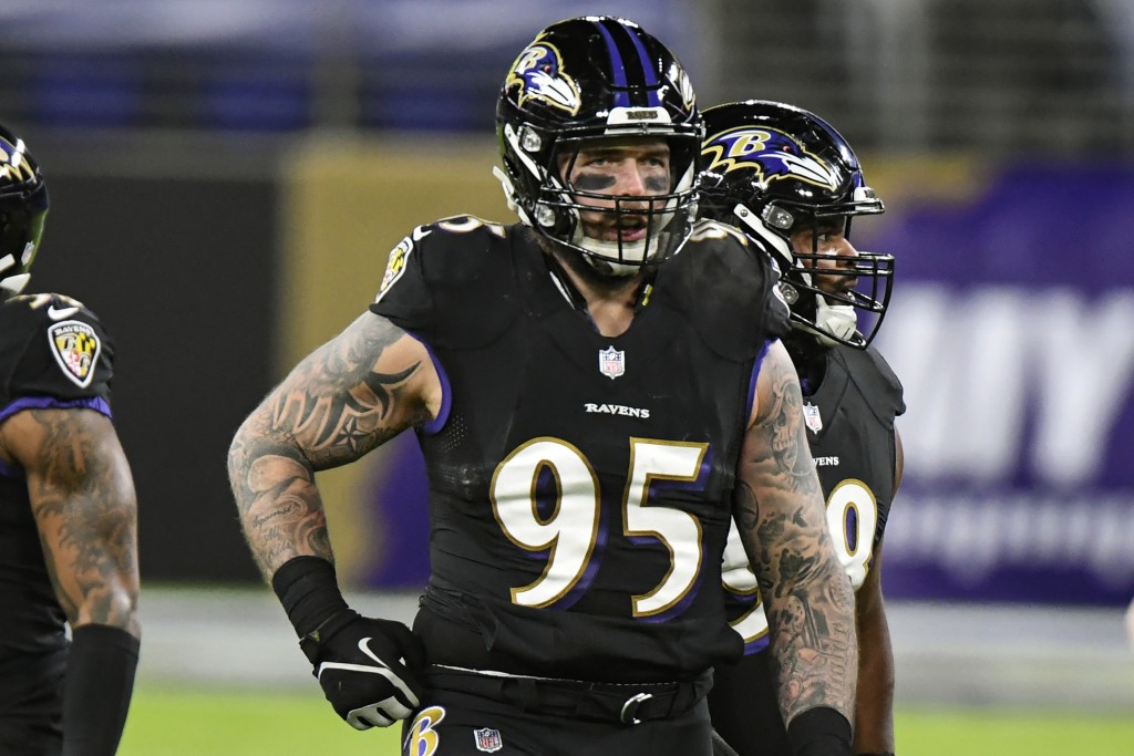 Baltimore Ravens defensive end Derek Wolfe (95) looks on during the first half of an NFL football game against the Dallas Cowboys, Tuesday, Dec. 8, 20...