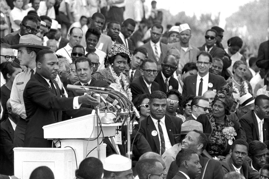 FILE - In this Aug. 28, 1963 file photo, the Rev. Dr. Martin Luther King Jr., head of the Southern Christian Leadership Conference, speaks to thousand...