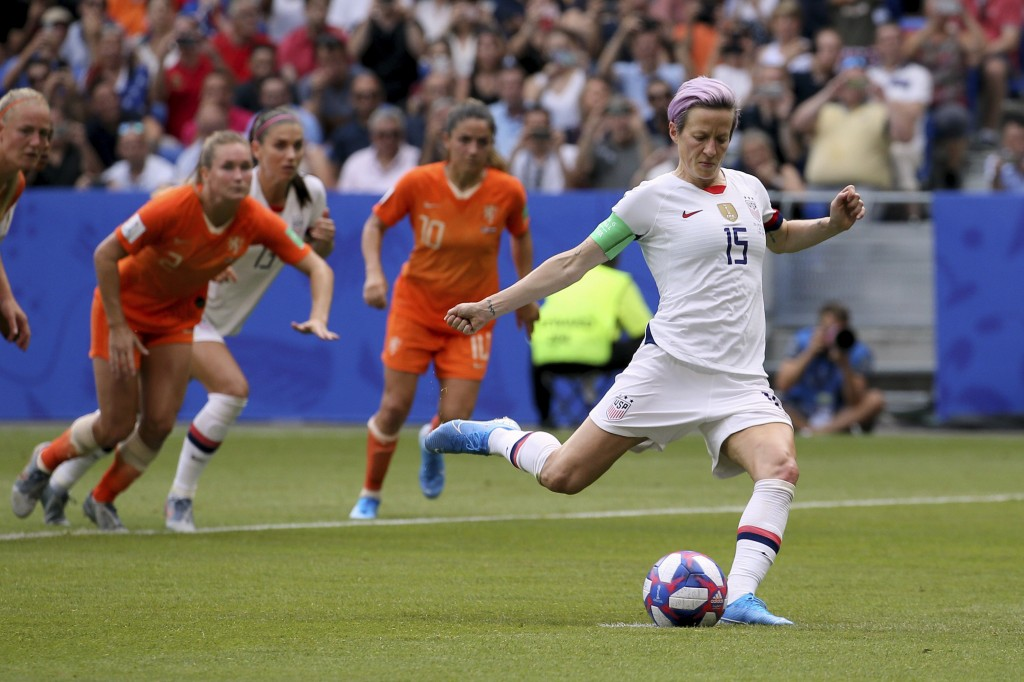 FILE - In this July 7, 2019, file photo, United States' Megan Rapinoe scores her side's opening goal from the penalty shot during the Women's World Cu...