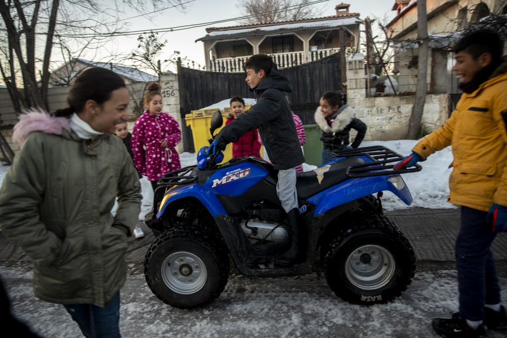 A child drives a quad at the Canada Real shanty town, outside Madrid, Spain, Tuesday, Jan. 12, 2021. An illegal informal settlement that has spread ov...