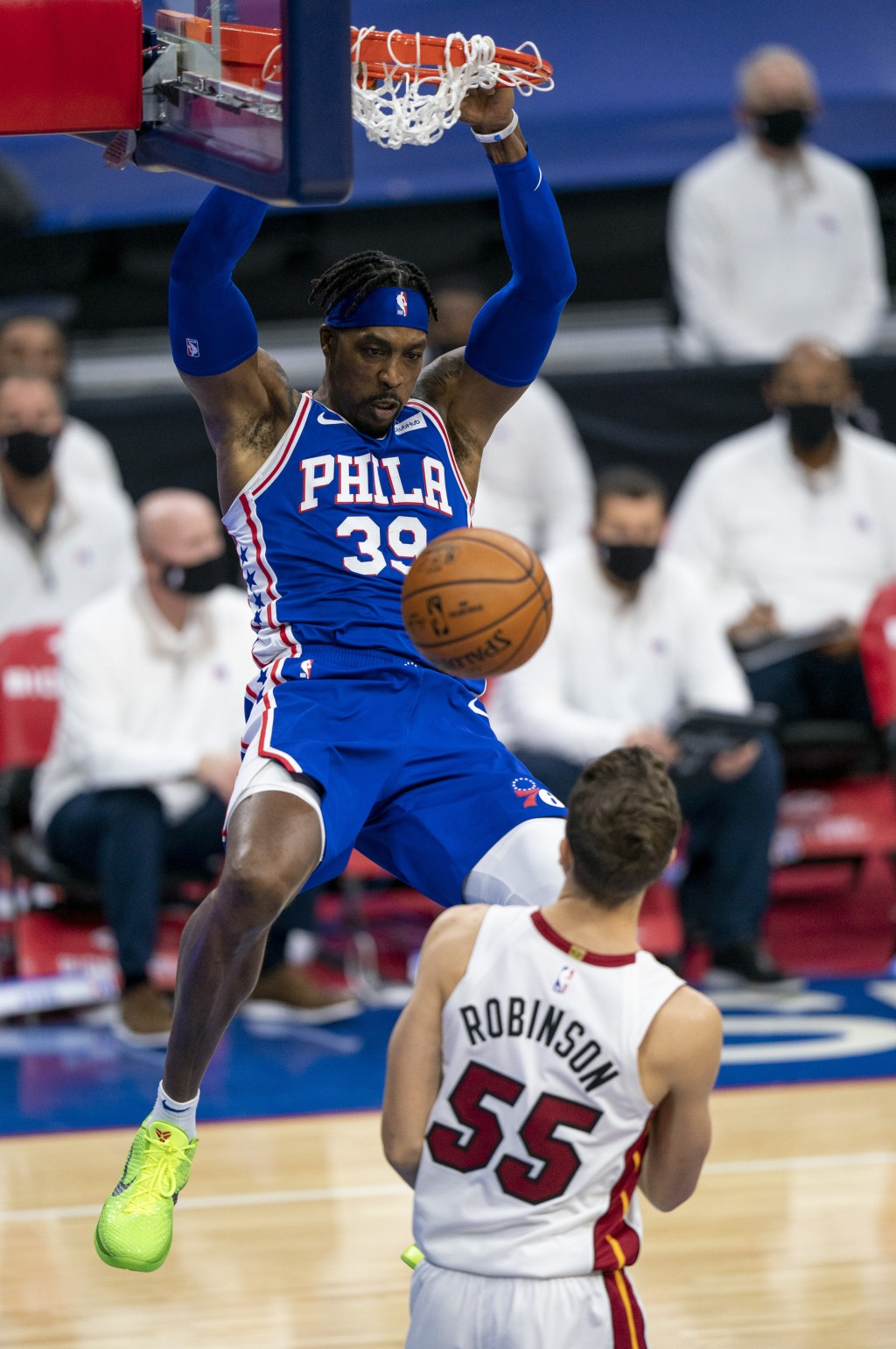 Philadelphia 76ers' Dwight Howard, left, dunks over Miami Heat's Duncan Robinson during the first half of an NBA basketball game Tuesday, Jan. 12, 202...
