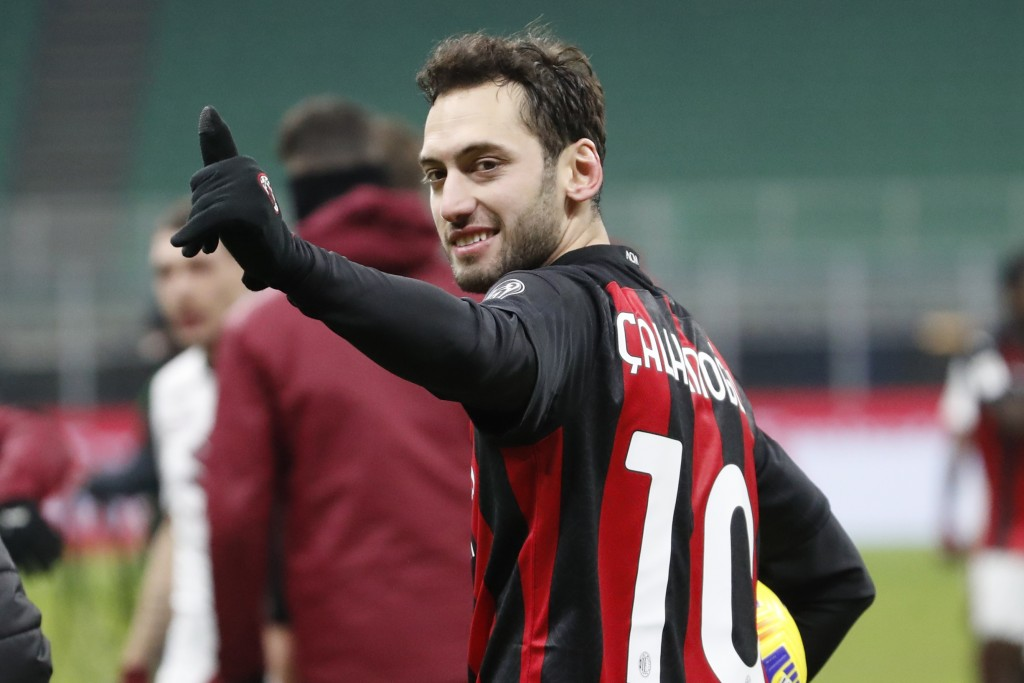 AC Milan's Hakan Calhanoglu celebrates after his team defeated Torino in the Italian Cup round of 16 soccer match between AC Milan and Torino at the S...