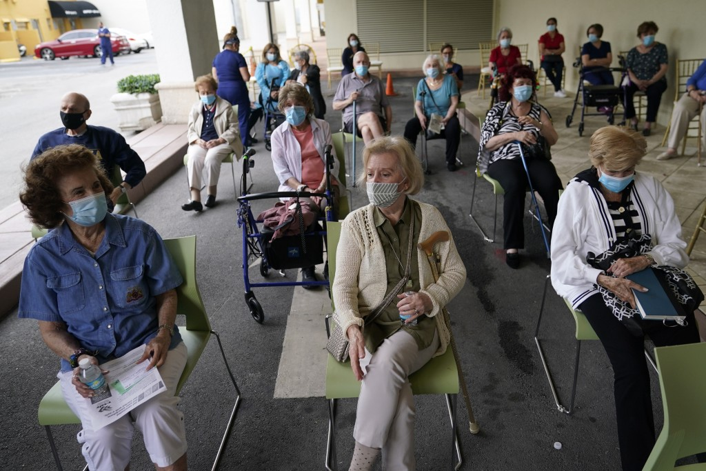 Residents wait to be cleared after receiving the Pfizer-BioNTech COVID-19 vaccine at the The Palace assisted living facility, Tuesday, Jan. 12, 2021, ...