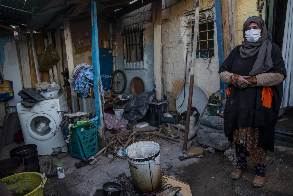 Ibilya El Kourchi stands in her house at the Canada Real shanty town, outside Madrid, Spain, Tuesday, Jan. 5, 2021. An illegal informal settlement tha...