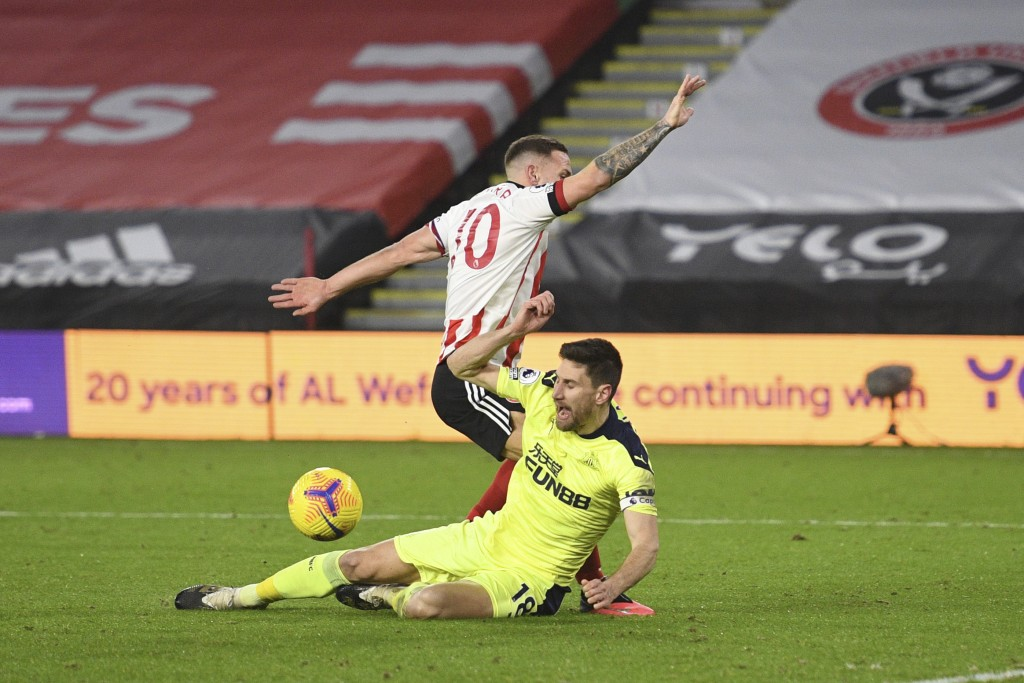 Sheffield United's Billy Sharp falls in the penalty area after a tackle by Newcastle's Federico Fernandez prompting a VAR check for penalty during the...