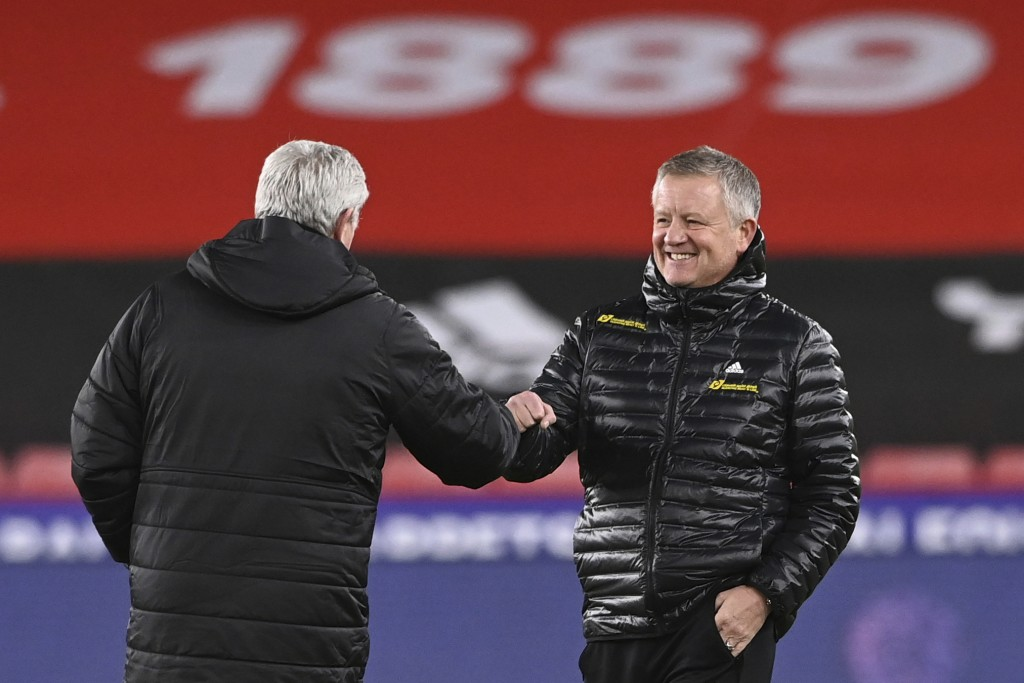 Sheffield United's manager Chris Wilder, right, greets Newcastle's head coach Steve Bruce before the English Premier League soccer match between Sheff...
