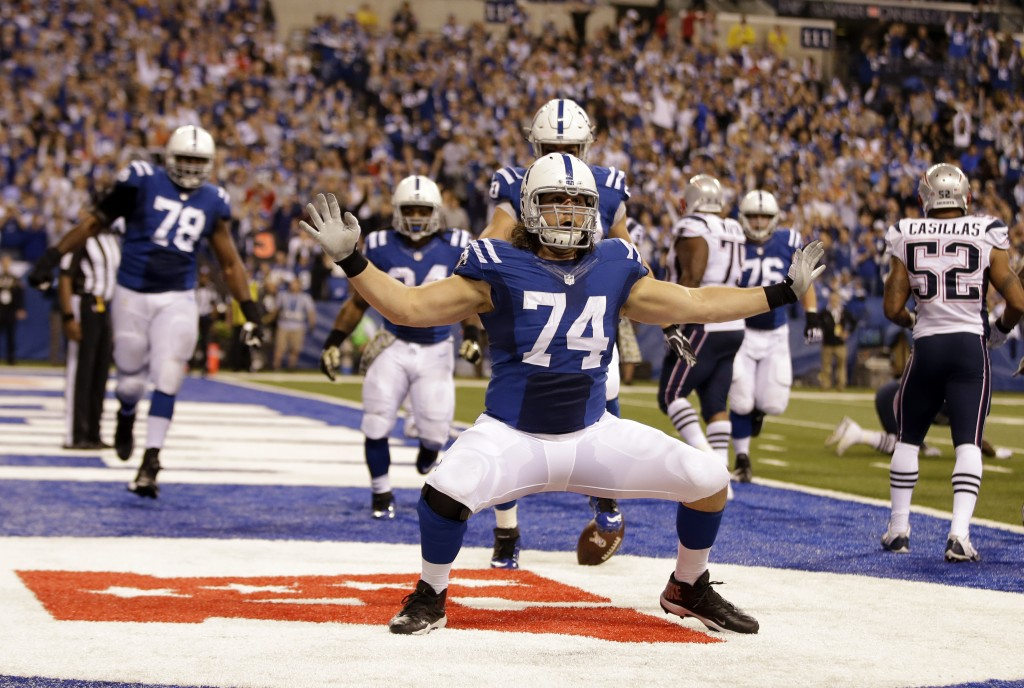 FILE - Indianapolis Colts tackle Anthony Castonzo celebrates after making a catch for a touchdown against the New England Patriots during the second h...
