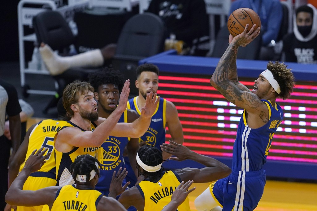 Golden State Warriors guard Kelly Oubre Jr. shoots against the Indiana Pacers during the first half of an NBA basketball game in San Francisco, Tuesda...