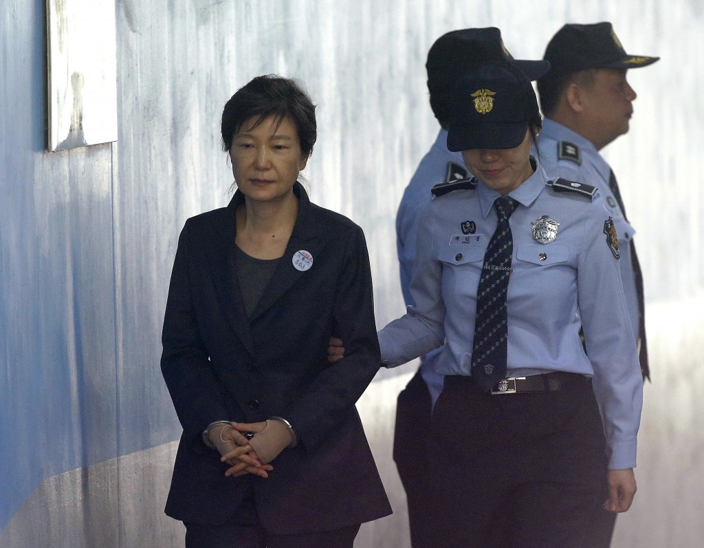 FILE - In this Oct. 10, 2017, file photo, former South Korean President Park Geun-hye, left, arrives to attend a hearing on the extension of her deten...