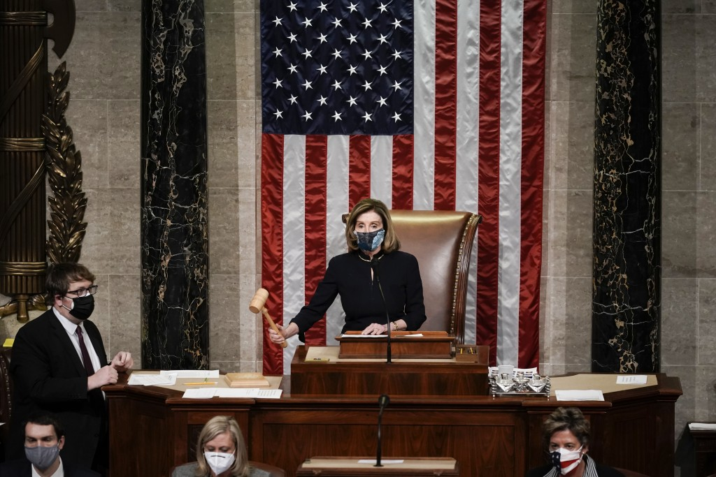 Speaker of the House Nancy Pelosi, D-Calif., gavels in the final vote of the impeachment of President Donald Trump, for his role in inciting an angry ...