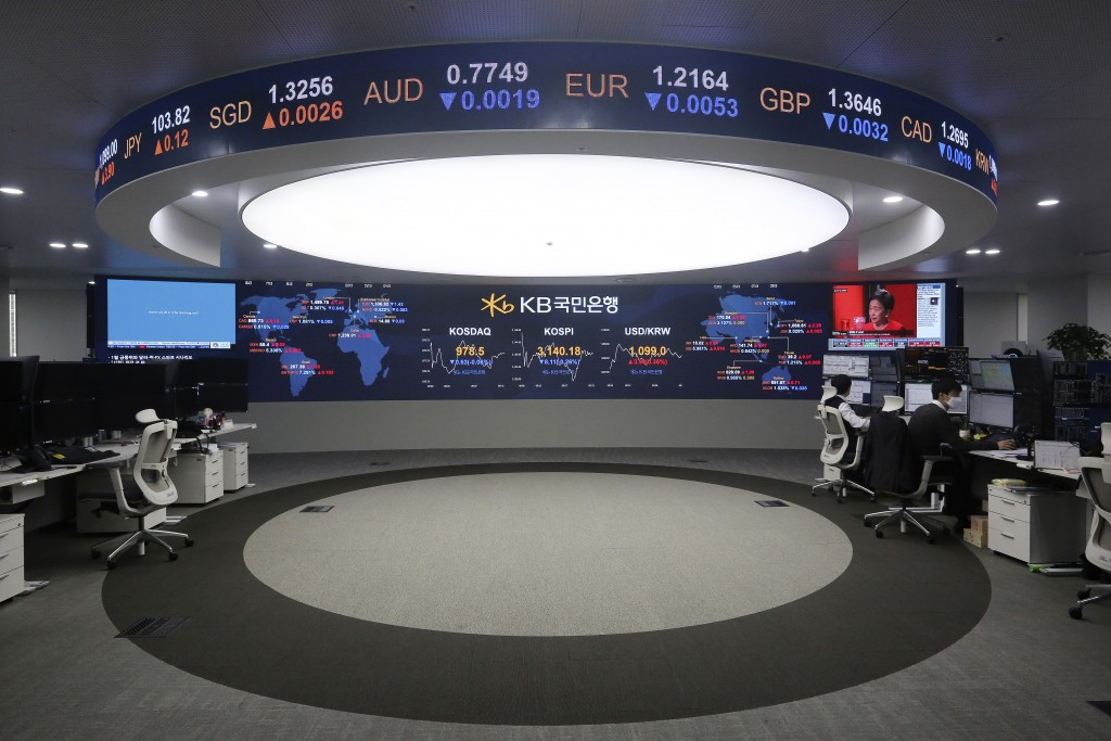 Currency traders work at the foreign exchange dealing room of a KB Kookmin Bank branch in Seoul, South Korea, Thursday, Jan. 14, 2021. Shares were mos...