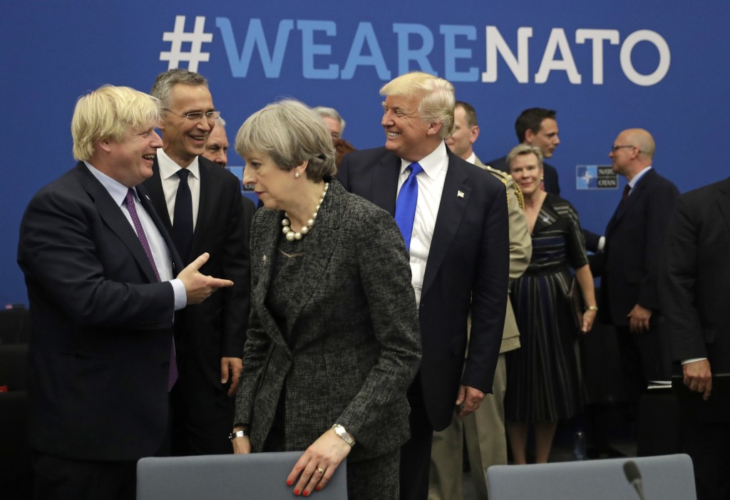 FILE - In this Thursday, May 25, 2017 file photo U.S. President Donald Trump jokes with British Foreign Minister Boris Johnson as British Prime Minist...