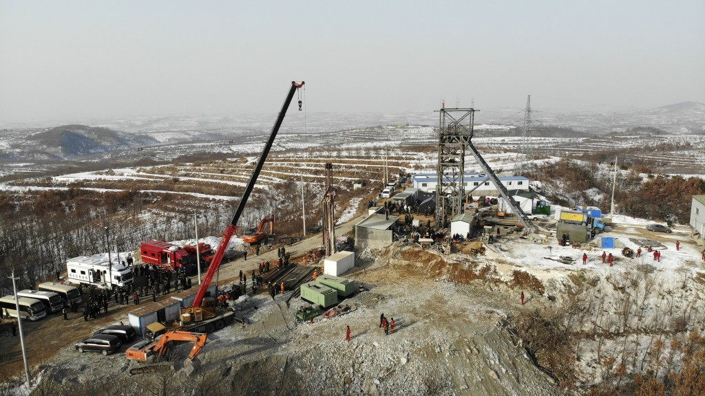 In this photo released by China's Xinhua News Agency, rescuers work at the site of a gold mine that suffered an explosion in Qixia in eastern China's ...