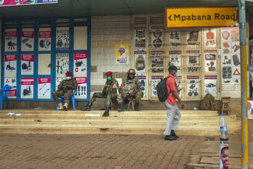 Security forces patrol the streets near opposition leader Bobi Wine headquarters in Kampala, Uganda Wednesday, Jan. 13, 2021. The United States ambass...