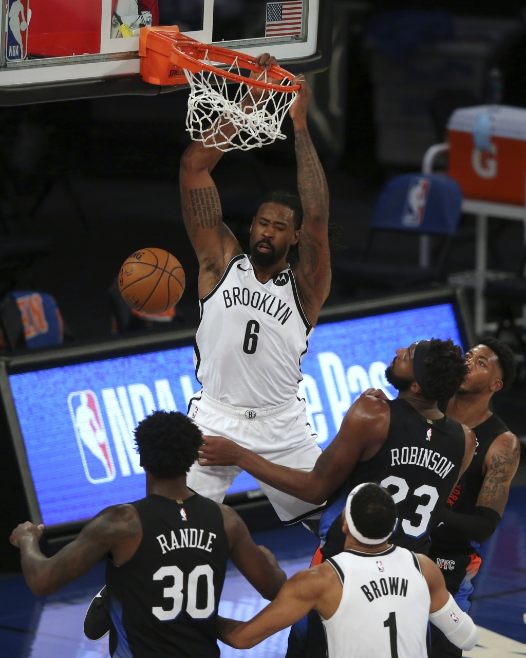 Brooklyn Nets center DeAndre Jordan (6) dunks against New York Knicks forward Julius Randle (30), center Mitchell Robinson (23) and guard Elfrid Payto...